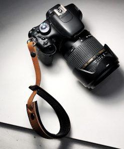 leren camera polsband met eigen tekst of logo Owned by